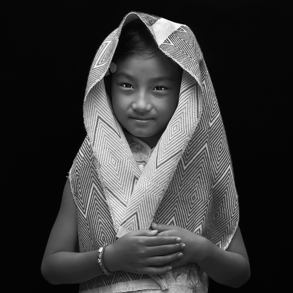 Girl wearing a Dong brocade scarf handmade by the Dong ethnic minority from Newchannel  program. This program brings more job opportunities to the local women and provides a   sustainable solution to the issue of the left-behind children in China.